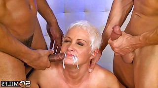 Hot and horny blonde mature serves two..