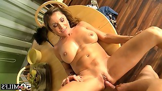 Nude mature with shaved pussy getting missionary sex on table with her sexy lover