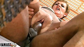 Mature in beige stockings sucks black cock..