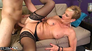 Hot 50 year old milf likes to suck and fuck on sofa with her partner in this tube movie