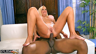 Torrid blonde mature in white stockings sucks black dick and next she jumps on it