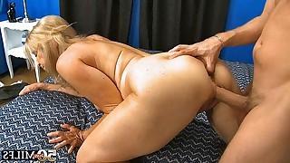 Blonde mature sucks mans tool whereupon guy fucks her pussy in various poses