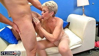 Busty granny riding on cock of guy after deep..