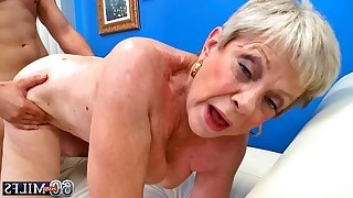 Tattooed guy and his torrid old mistress show hardcore scenes on white luxury sofa