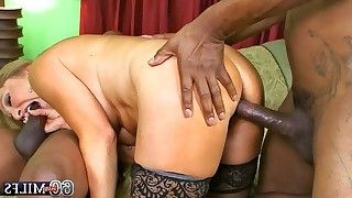 Mature gets double penetration by dark guys from both ends in interracial group action