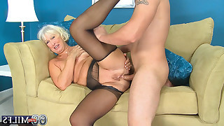 Busty blonde granny in black stockings sucking..