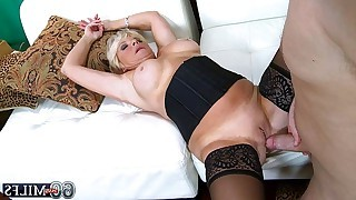 Blonde mature plays with dick so as to shows..