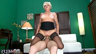 Horny blonde mature in stockings shows skill of..