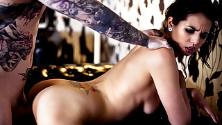 Tattooed bombshell sucks and fucks hard wet cock..