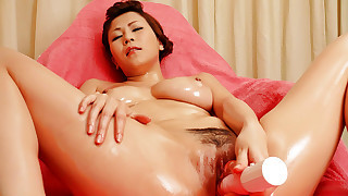 Yuki Aida is oiled up at the hospital and left to her own devices she begins to fondle her tits..