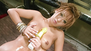 Japanese av model Hina Maeda in gold lame strips and teases her titties
