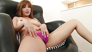 Rika Aina in fishnet nylons plays with her furry..