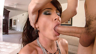 Busty MILF blowing and using face as cum target..