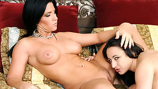 Dark haired MILF shows this young girl how to eat good pussy