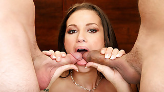 Amazing brunette enjoys sucking 2 cocks at the same time