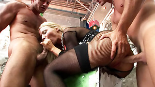 Big titted blonde takes on two guys in all her slutty holes!