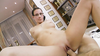 Young massage therapist strokes Rocco's cock with her pussy.