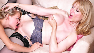 Nina Hartley seduces young hot blonde into..