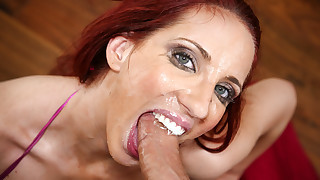 Redhead babe Anika Allbrite is swallowing huge..