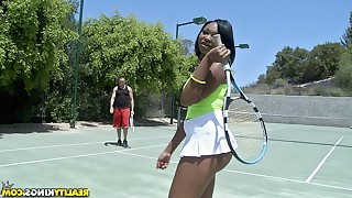 Dark babe is posing outdoors, while wearing tennis uniform