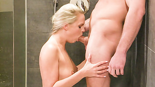Beautiful blonde blows some guy's big cock while..